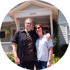 Homeowners in front of their house